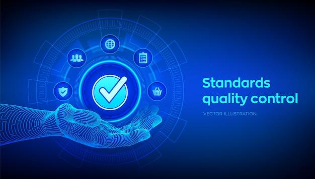 Controle de qualidade de padrões iso. sinal aceito na mão robótica. Vetor Premium