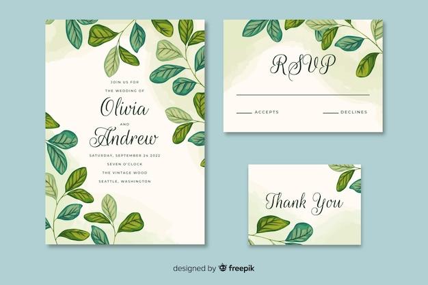 Convite de casamento com folhas de mão desenhada Vetor grátis