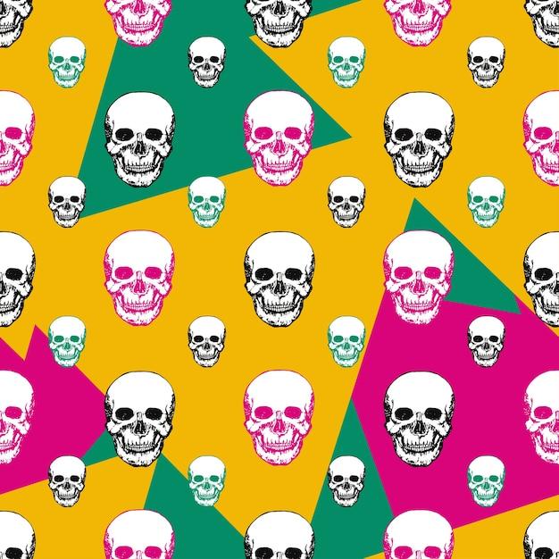 Cópias coloridas dos crânios. padrão de crânio sem costura. Vetor Premium