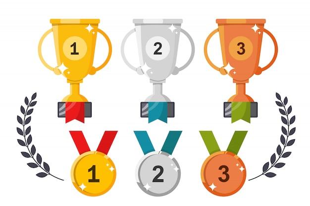 Copos e medalhas. conjunto de prêmios em um Vetor Premium
