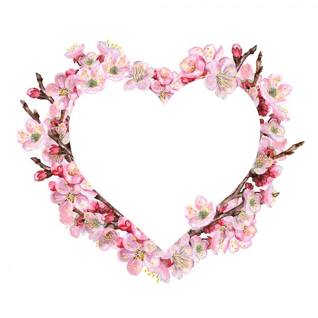 Coração com ramos de flores rosa Vetor Premium