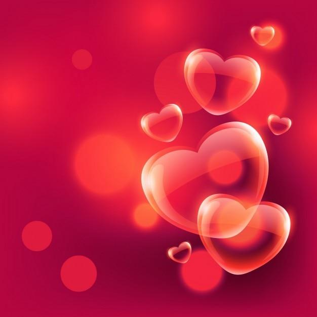 corações bonitos do amor bolhas que flutuam no ar no fundo vermelho do bokeh Vetor grátis