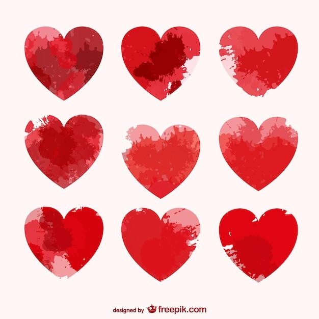 Corações do vetor com manchas de tinta Vetor grátis