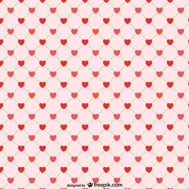 Corações vermelhos fundo padrão Vetor grátis