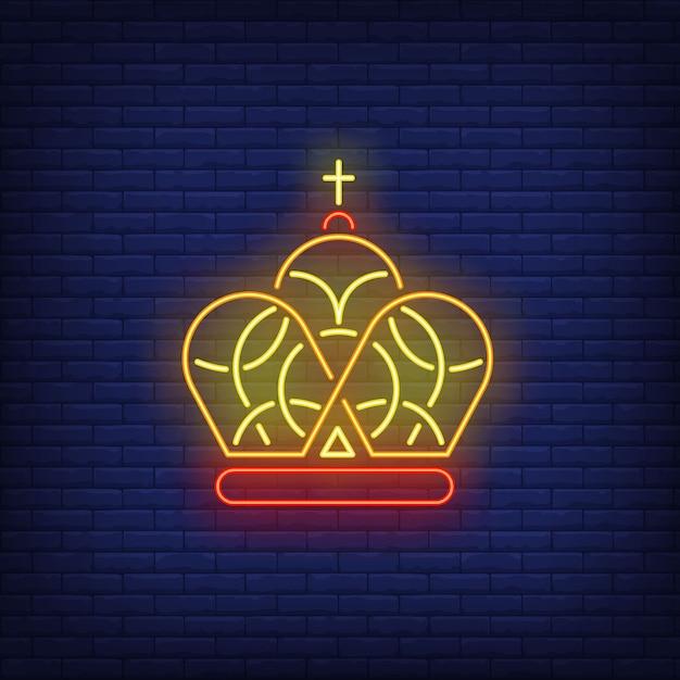 Coroa com cruz sinal de néon Vetor grátis