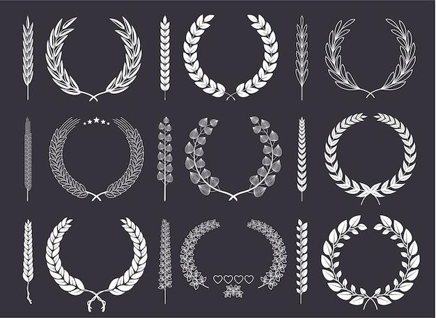 Coroa de louros e coleção de vetores de ramos Vetor Premium