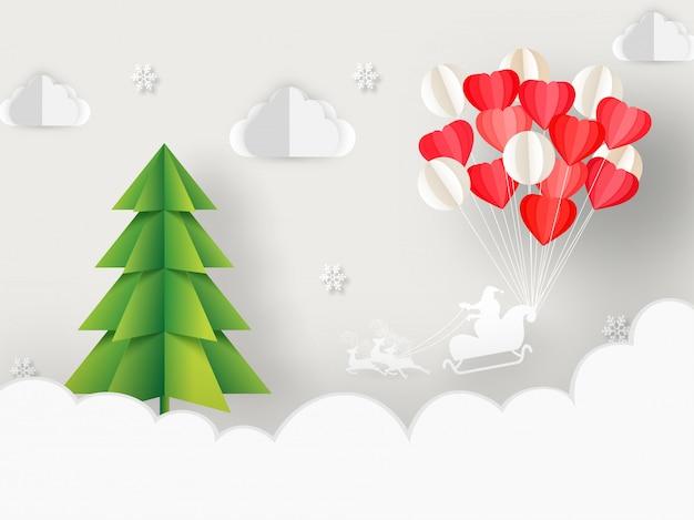 Corte de papel estilo árvore de natal, monte de balão e silhueta santa andar de trenó de renas em fundo nublado Vetor Premium
