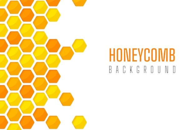 Corte de papel hexagonal amarelo dourado com padrão de favo de mel Vetor Premium