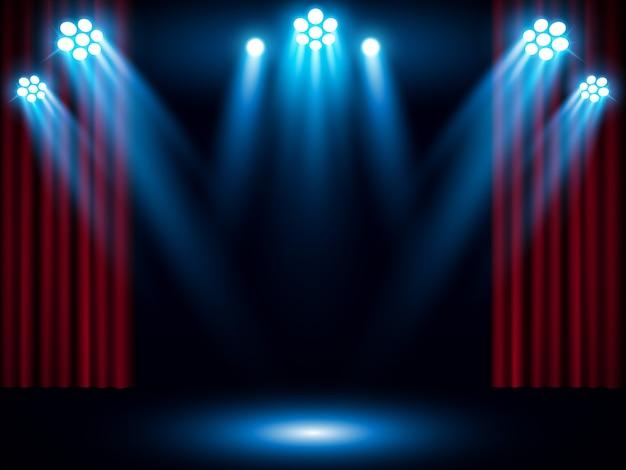 Cortina de palco vermelho com holofotes azul Vetor Premium