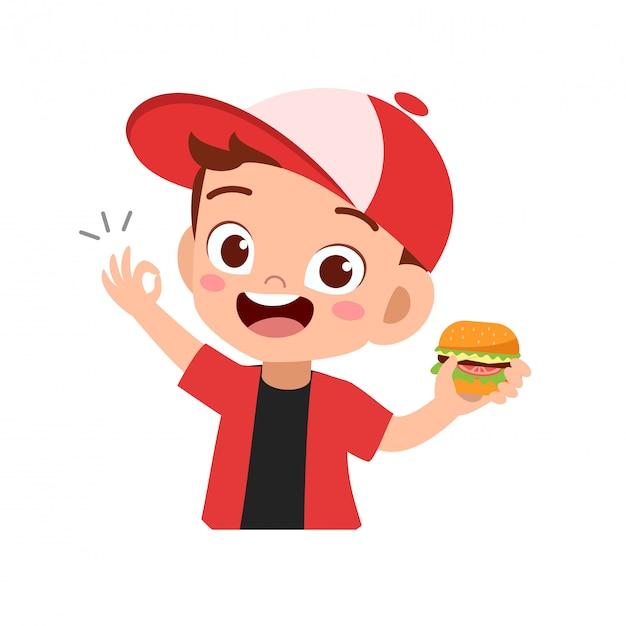 Criança feliz comendo Vetor Premium