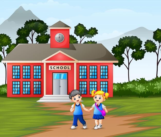 Crianças andando na frente do prédio da escola Vetor Premium