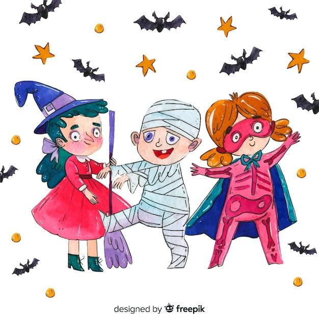 Crianças dançando na coleção de halloween de trajes Vetor grátis