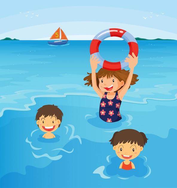 Crianças de praia Vetor grátis