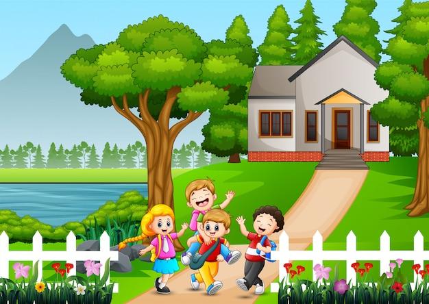 Crianças em idade escolar feliz indo para a escola Vetor Premium