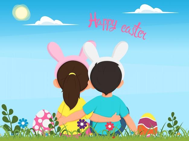 Crianças em trajes de coelhos sentam na grama entre os ovos de páscoa e olham para o lindo céu da primavera. Vetor Premium