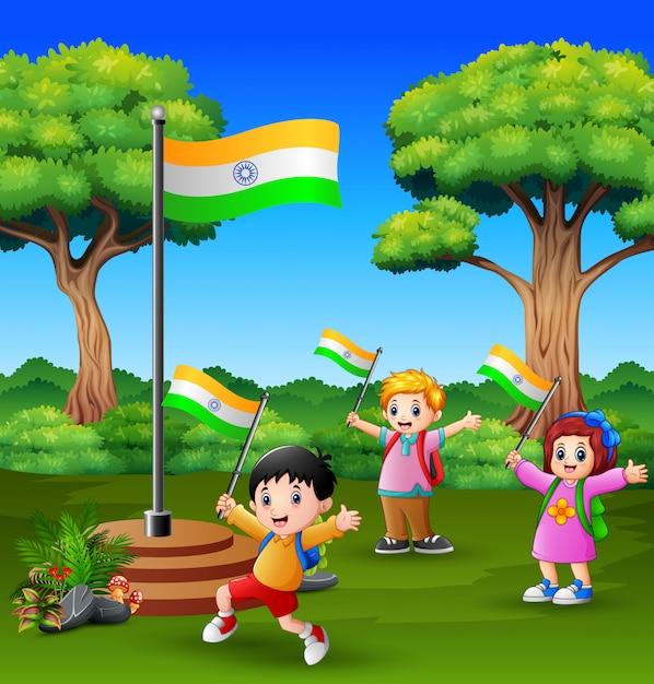 Crianças felizes comemorando o dia da república da índia sobre a natureza Vetor Premium
