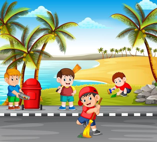 Crianças limpando a estrada perto da praia das coisas perigosas para torná-lo limpo Vetor Premium