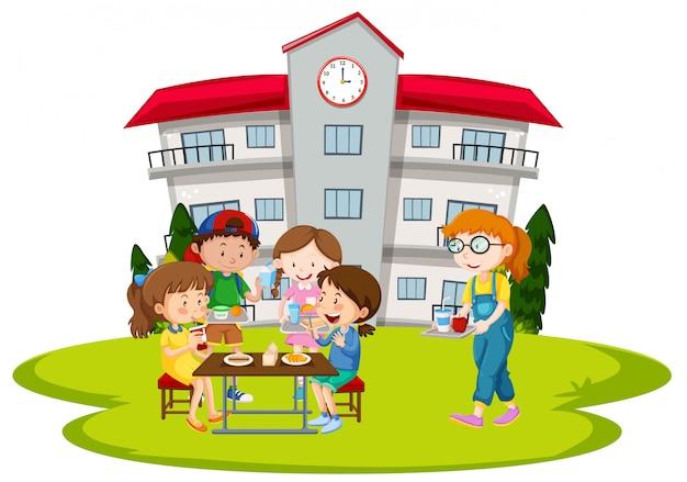 Crianças, tendo almoço, em, escola Vetor grátis
