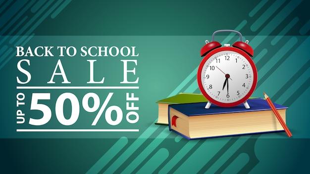 De volta à venda da escola, desconto banner web com despertador Vetor Premium
