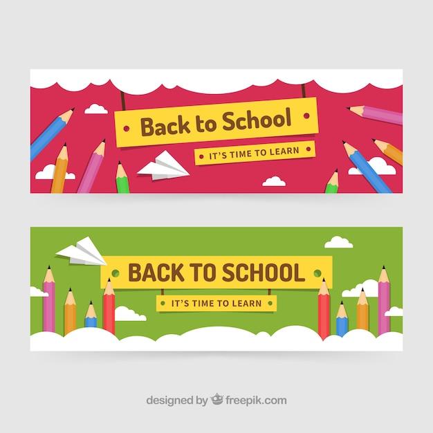 De volta aos banners da escola com lápis de cor Vetor grátis