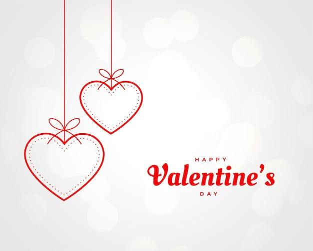 Decoração de corações pendurados para o dia dos namorados Vetor grátis