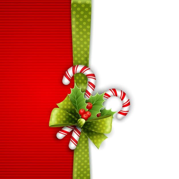Decoração de natal com folhas de azevinho e doces Vetor Premium