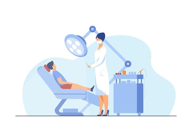 Dentista feminino curando menino na cadeira. dente, tratamento, ilustração em vetor plana dor de dente. conceito de estomatologia e medicina Vetor grátis