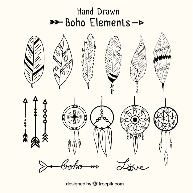 Desenhadas mão dreamcatchers e elementos étnicos Vetor Premium
