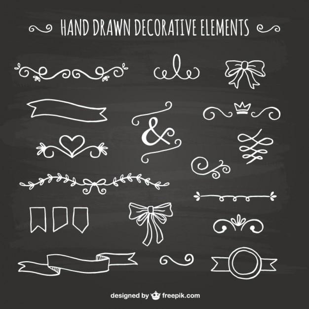 Desenhadas mão elementos decorativos Vetor grátis