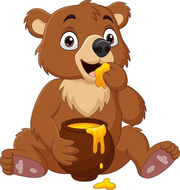 Desenhos Animados Bebe Urso Sentado E Comendo Mel Da Panela Vetor Premium