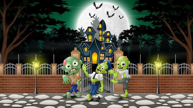 Desenhos animados do grupo de zumbis no dia de halloween Vetor Premium