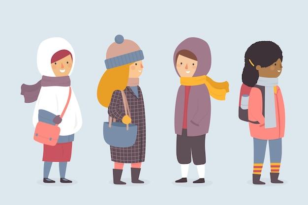 Desenhos animados, vestindo roupas de inverno em fundo azul Vetor grátis