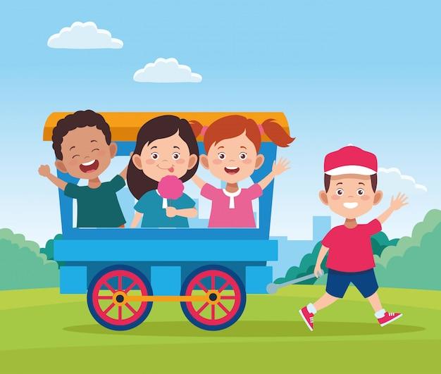 Design de dia feliz crianças com vagão de trem com crianças felizes dos desenhos animados Vetor Premium