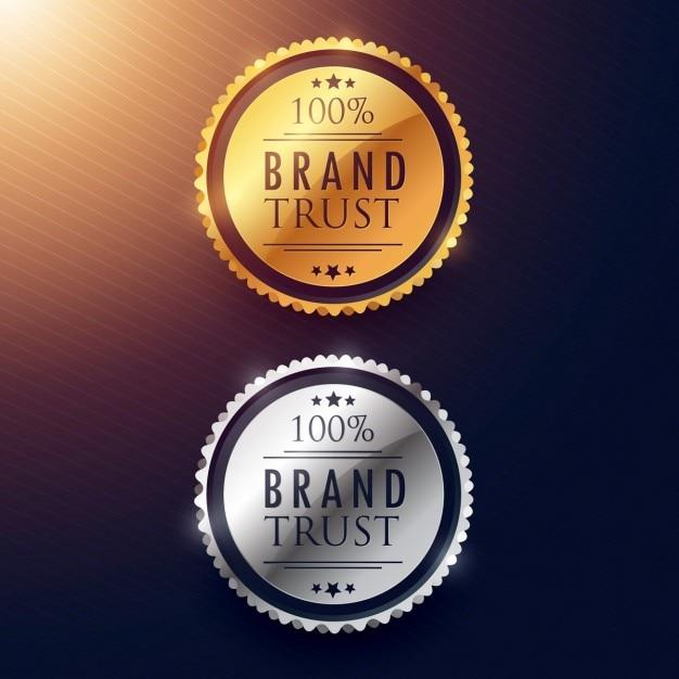 Design de etiquetas confiança na marca em ouro e prata Vetor grátis
