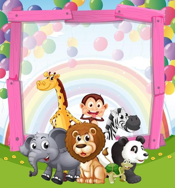 Design de fronteira com animais selvagens no campo Vetor Premium