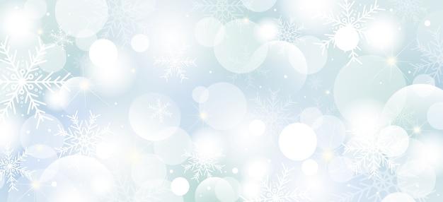 Design de fundo de natal de flocos de neve e luzes de bokeh Vetor Premium