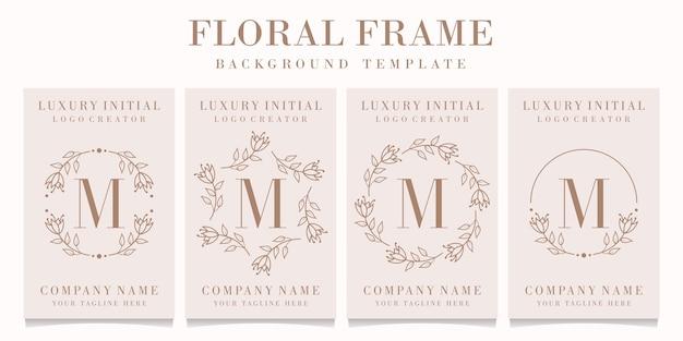 Design de logotipo da letra m com modelo de moldura floral Vetor Premium