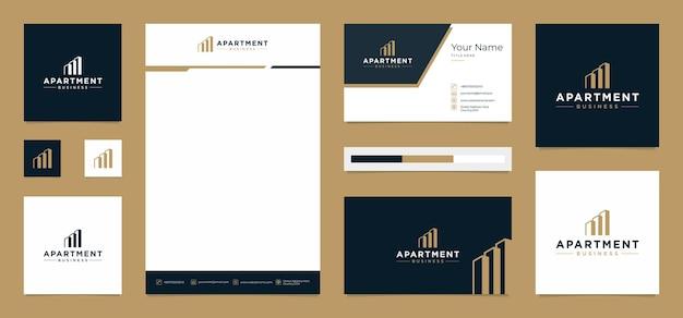 Design de logotipo de prédio de apartamentos com cartão de visita e papel timbrado Vetor Premium