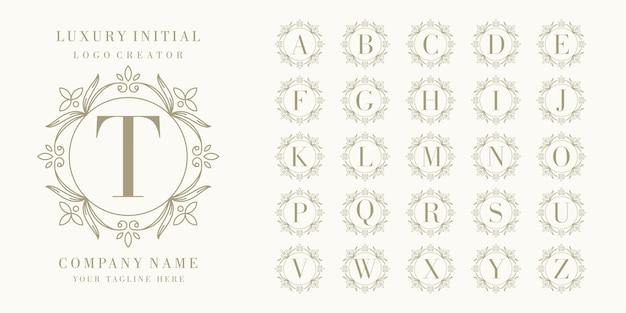 Design de logotipo inicial premium com moldura floral Vetor Premium