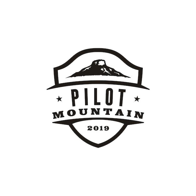 Design de logotipo retro vintage piloto montanha Vetor Premium