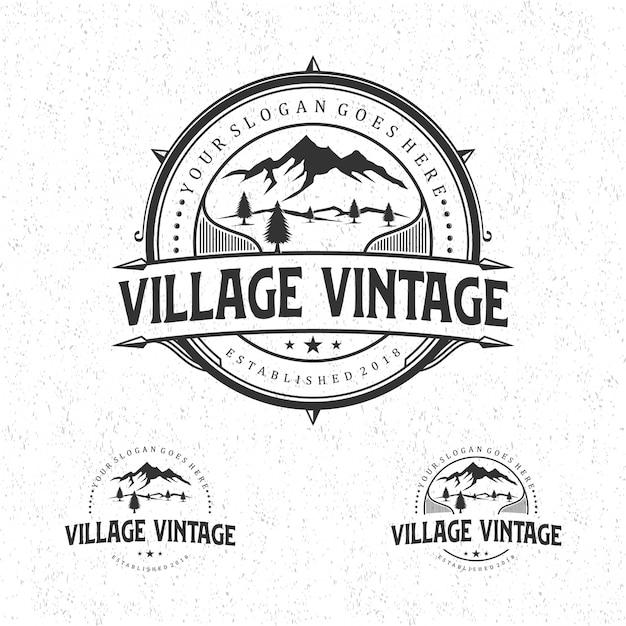 Design de logotipo vintage de aldeia Vetor Premium