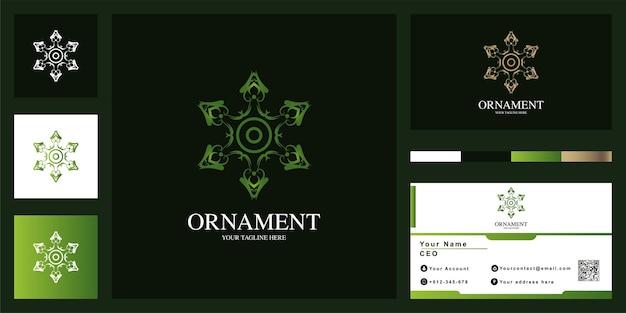 Design de modelo de logotipo de luxo estrela ou ornamento com cartão de visita. Vetor Premium