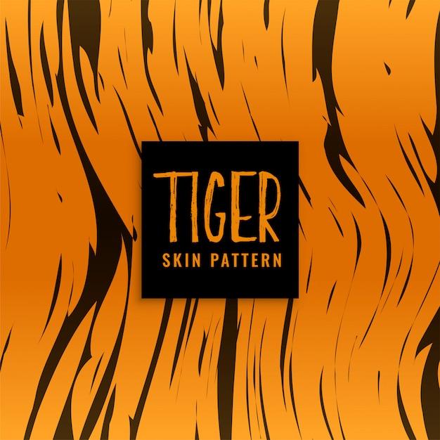Design de textura de pele de padrão de tigre Vetor grátis