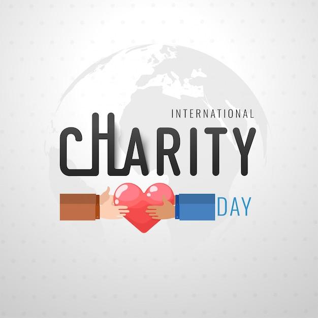 Design internacional do dia da caridade com ilustração de mãos segurando um coração Vetor Premium