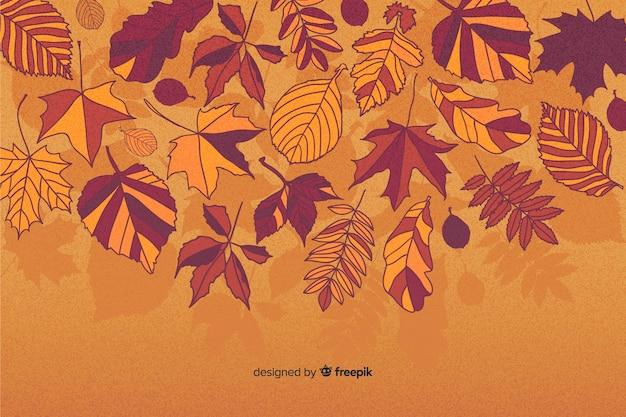 Design plano de fundo de folhas de outono Vetor grátis