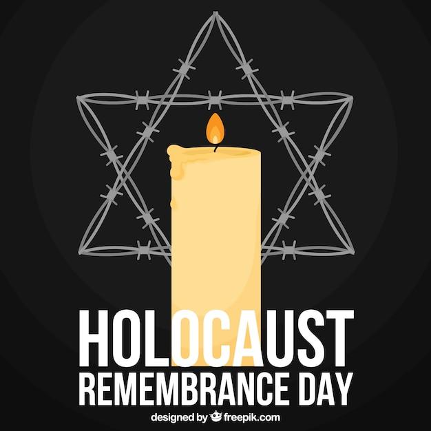 Dia da lembrança do holocausto, uma vela e uma estrela em um fundo preto Vetor grátis