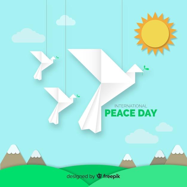 Dia da paz com pombas de origami Vetor grátis
