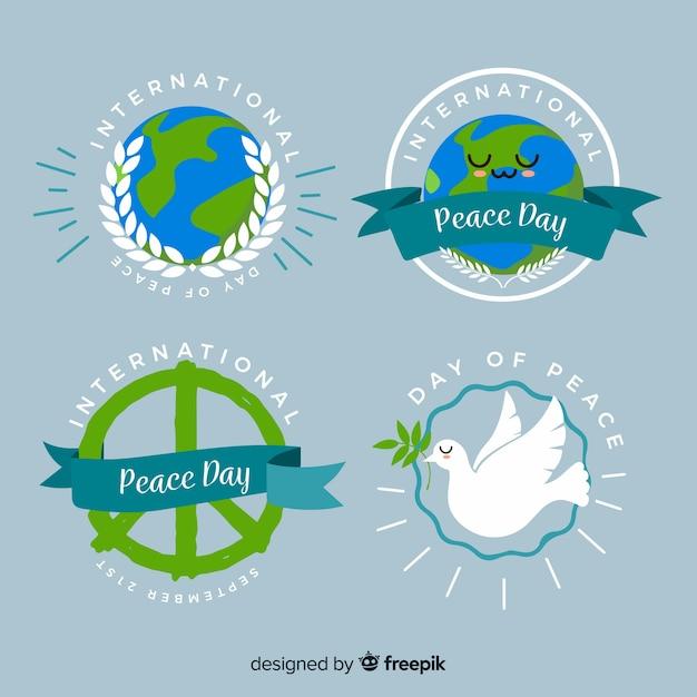 Dia da paz plana rodada coleção de crachá Vetor grátis