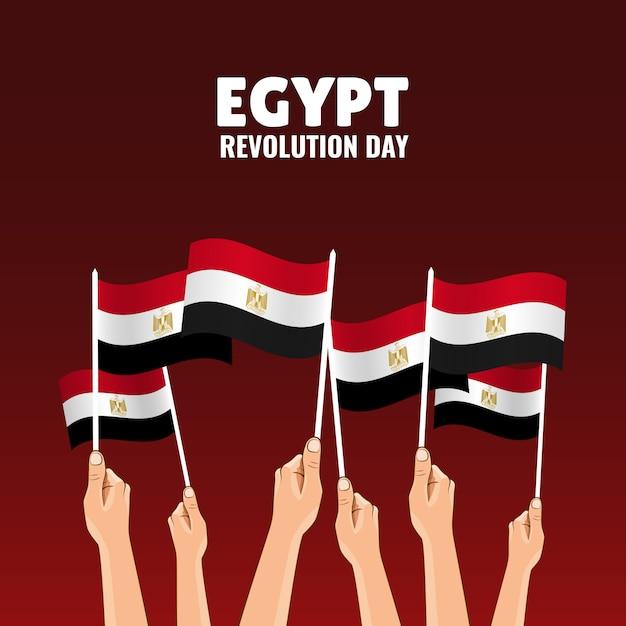 Dia da revolução no egito. as mãos seguram as bandeiras do país Vetor Premium