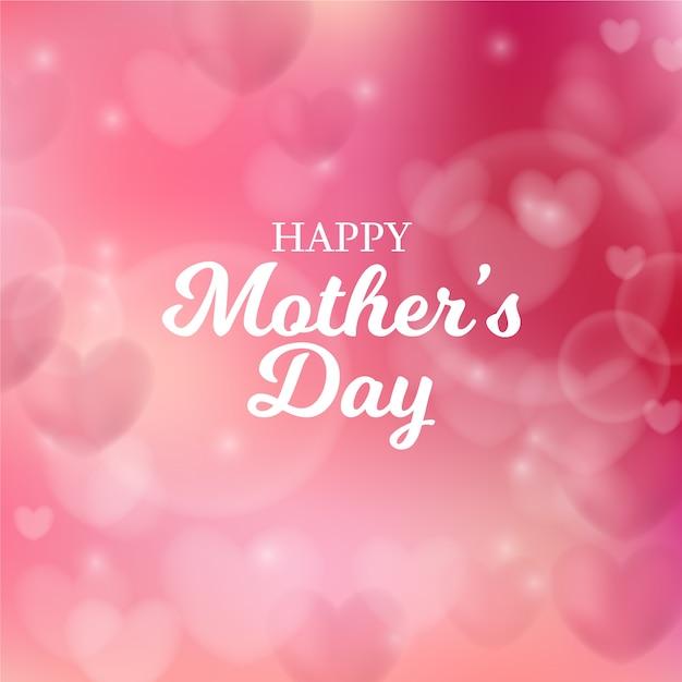 Dia das mães turva com corações e saudação Vetor grátis